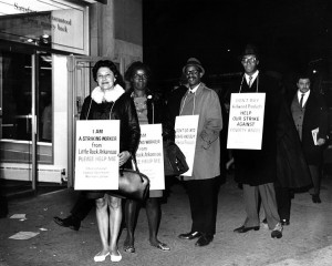 African American and Hispanic American workers on strike against Kellwood, wearing placards that encourage support for better wages