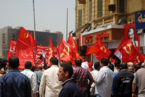 Egyptian workers carrying Communist Party flags in Tahrir square.