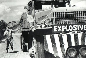 man runs after explosives truck, scene from the Wages of Fear
