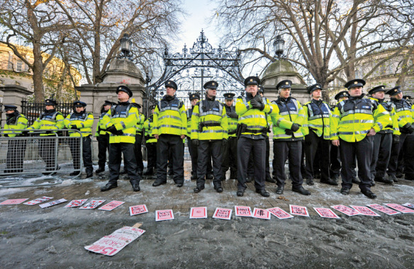 The repressive state apparatus - Photo by Barbara Lindberg / Rex, Features a deck of large cards carrying protest slogans lies spread out on the ground in front of a large police contingent protecting the front gates of Leinster House - Dail Eireann during a splinter group protest. Demonstration to protest Austerity Plan, Dublin, Ireland - 27 Nov 2010